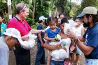 During his 2009 visit to Nicaragua Andrew helped Ambassador's staff member, Pastor Daniel Ortega Reyes (far right) distribute food.